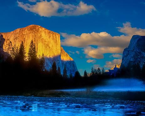 Merced River Flows Through Yosemite Valley below El Capitan at sunset, CA