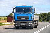 Nizhny Novgorod Region, Russia - August 21, 2020: Blue flatbed truck MAZ 5340 at the interurban road.