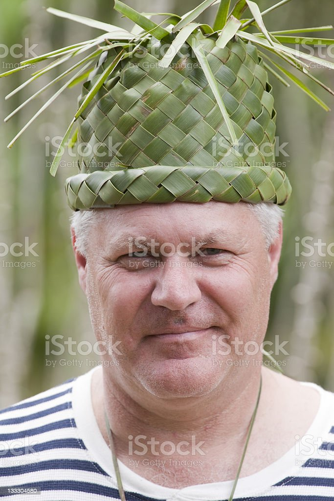 SHY MAN WITH A GREEN STRAW HAT stock photo