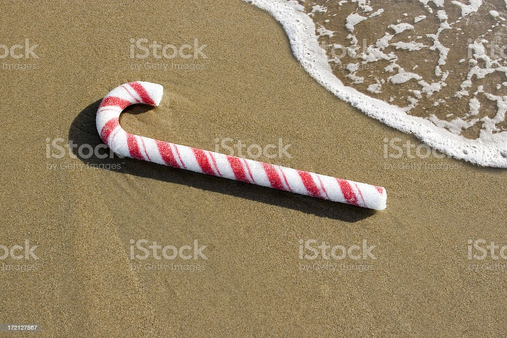 CANDY CANE AT THE BEACH royalty-free stock photo
