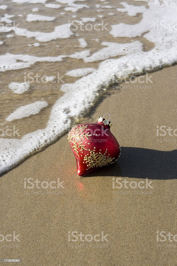 CHRISTMAS ORNAMENT IN THE SAND stock photo