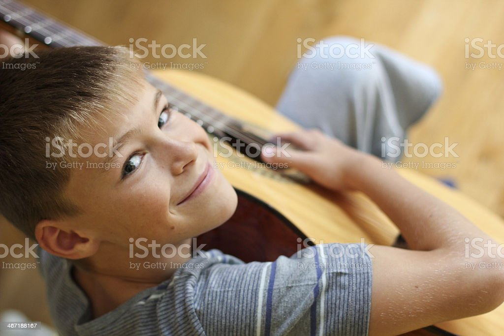 LITTLE BOY WITH GUITAR stock photo