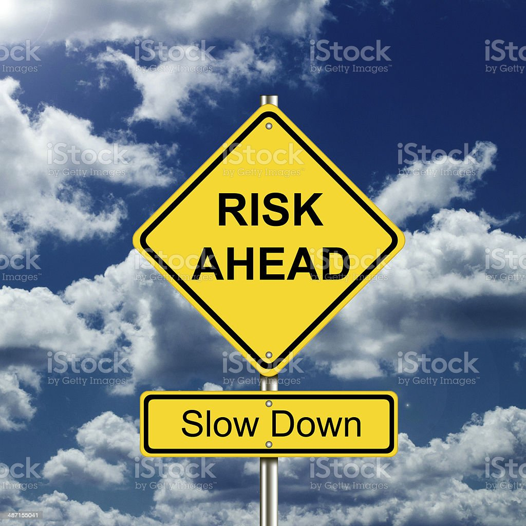 RISK AHEAD ROAD SIGN stock photo