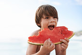 A happy little boy biting into a watermelonhttp://195.154.178.81/DATA/i_collage/pi/shoots/783413.jpg