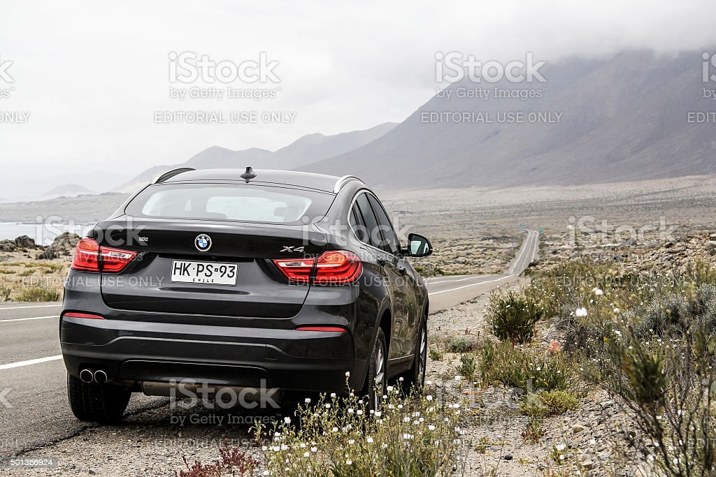 BMW F26 X4 Atacama, Chile - November 14, 2015: New black crossover BMW F26 X4 is parked at the roadside. 4x4 Stock Photo