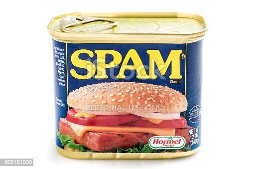 Miami, Florida, USA- May 27, 2015: A 12 ounces can of Clasic SPAM isolated on a white background. Spam stands for Spiced Pork and Ham, which is a canned precooked meat product. It is made by the Hormel Foods Corporation and was introduced in 1937.