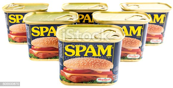 Miami, Florida, USA - May 29, 2015: Seven cans of SPAM isolated on a white background. Spam stands for Spiced Pork and Ham, which is a canned precooked meat product. It is made by the Hormel Foods Corporation and was introduced in 1937.