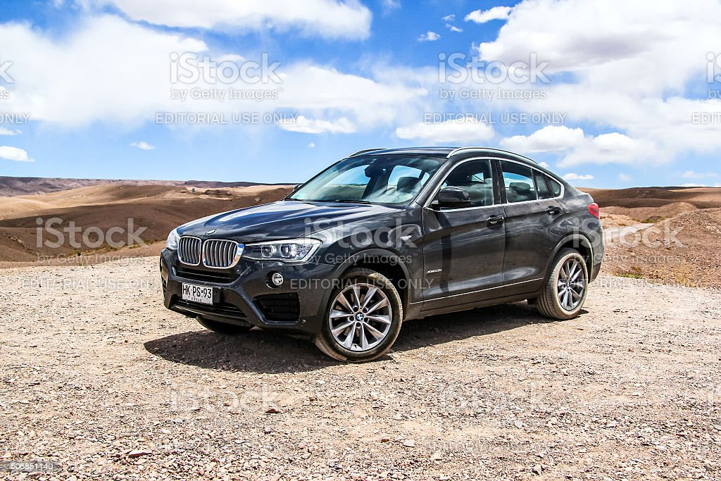 BMW F26 X4 Antofagasta, Chile - November 15, 2015: New black crossover BMW F26 X4 is parked at the Atacama desert. 4x4 Stock Photo