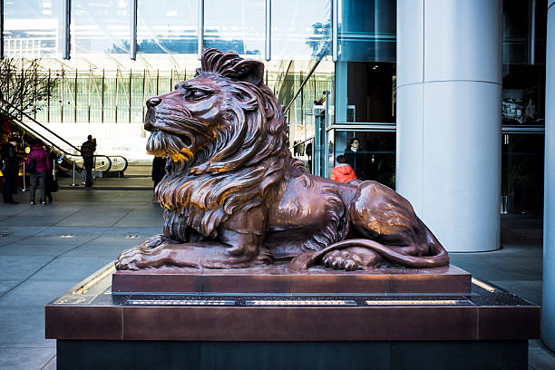 HSBC Hong Kong, China - January, 25 2016: A lion sculpture is displayed in front of the headquarter of HSBC building in Central, Hong Kong. hsbc stock pictures, royalty-free photos & images