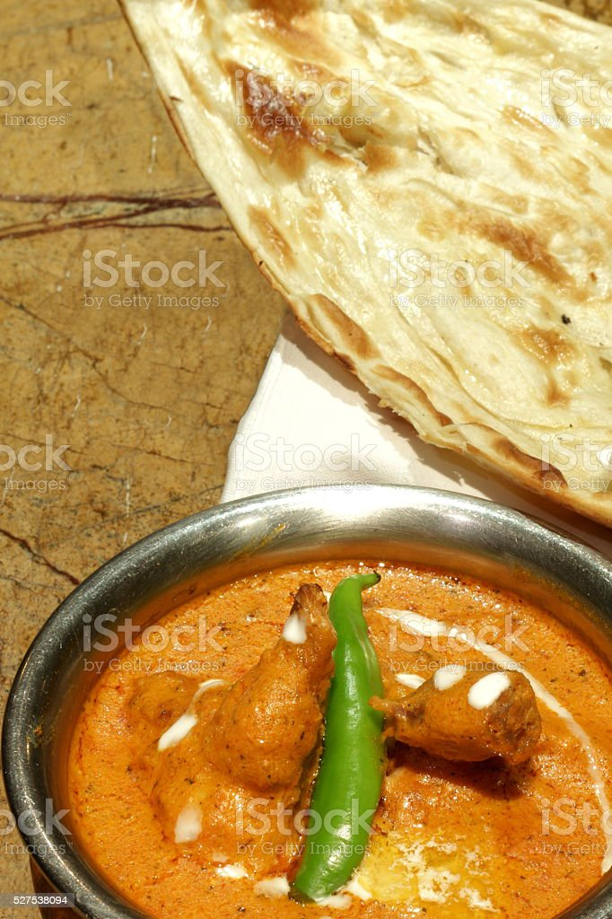 NAAN WITH BUTTRER CHICKEN 0R MURGH MAKHANI stock photo