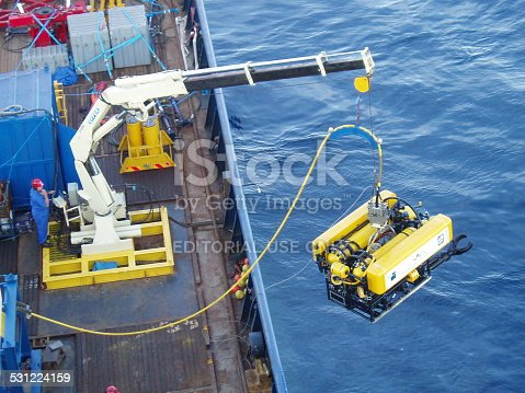 Taranto, Italy - June 23rd, 2005: The UK Submarine Rescue Service's remotely operated vehicle (ROV) being launched. This will be used to clear debris from around a stricken submarine and to deliver survival stores to buy time until a rescue can be mounted. Training exercises are held about 4 times a year.
