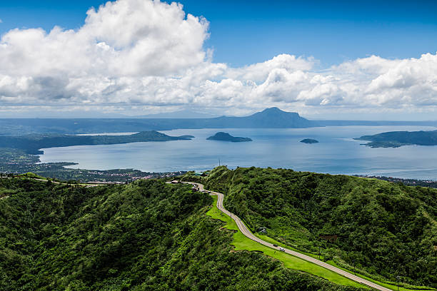 MOUNTAIN ROAD BEAUTIFUL GREEN BLUE LANDSCAPE TAGAYTAY PHILIPPINES stock photo