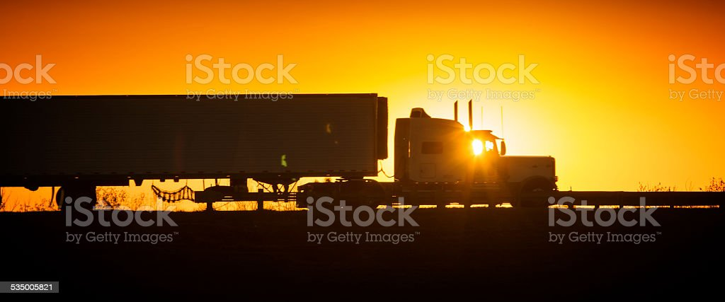 TRUCKER SUNRISE stock photo
