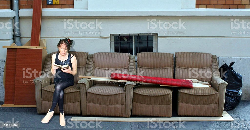READING POETRY ON A GERMAN SOFA stock photo