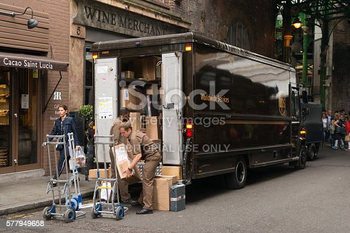 London, United Kingdom - June 17, 2016: The Borough Market in Southwark late in the day as UPS delivers packages.