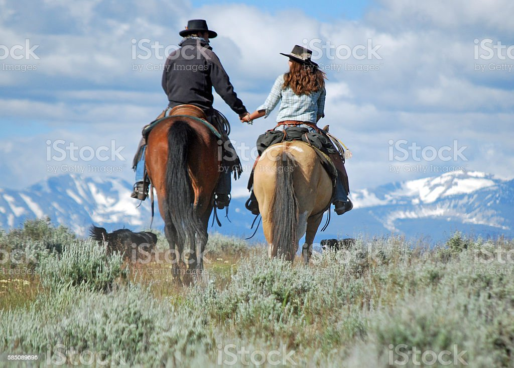 COWBOY AND HIS SWEETHEART stock photo
