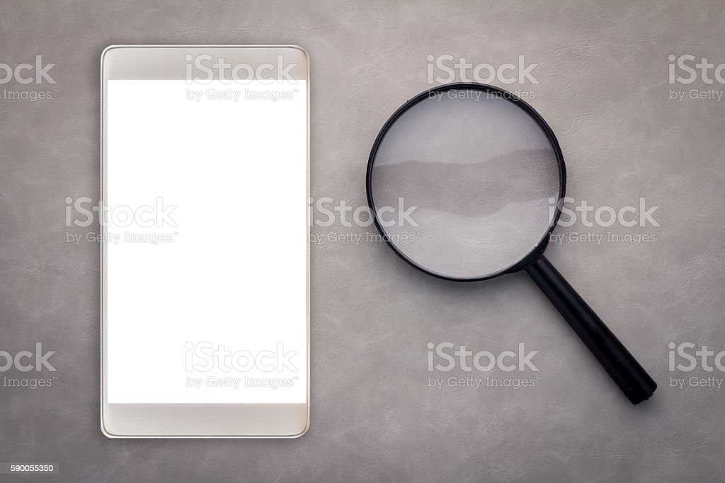SMARTPHONE WITH MAGNIFYING GLASS stock photo