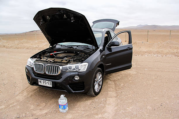 BMW F26 X4 Copiapo, Chile - November 14, 2015: Motor car BMW F26 X4 with an opened bonnet is parked in the Atacama desert. vehicle hood stock pictures, royalty-free photos & images