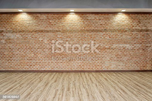 istock BRICK WALL WITH WOOD FLOOR BACKGROUND 591826942