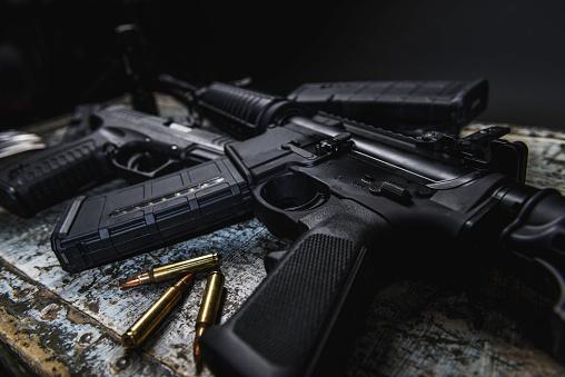 AR 15 with ammunition laying near it.