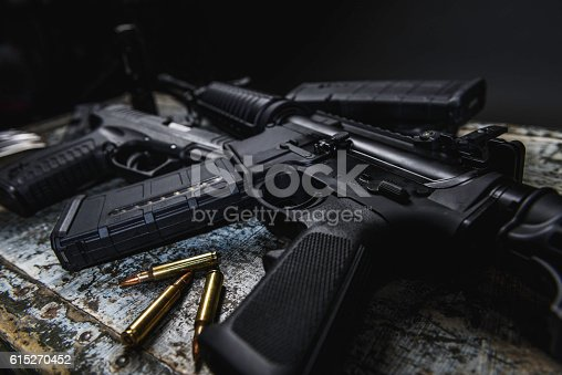 AR 15 with ammunition laying near it.