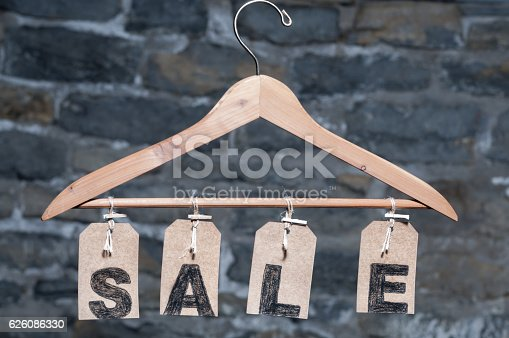 A stock photo of SALE tags hanging from a hanger