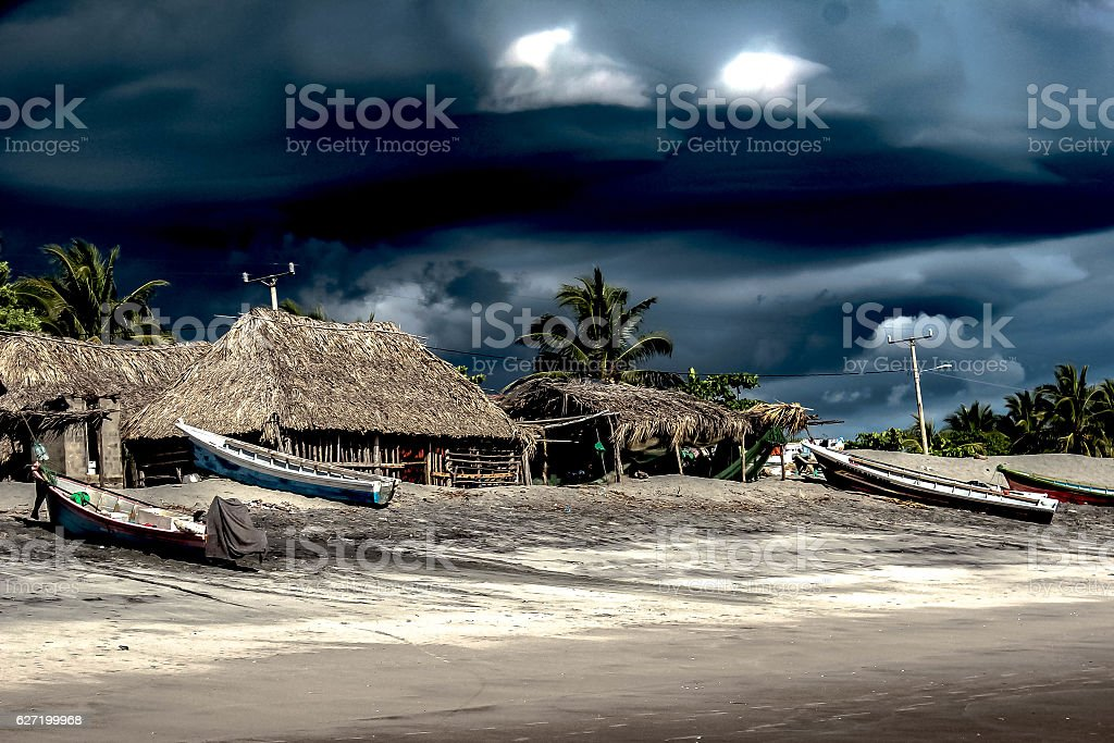 BEACH HUTS BEFORE THE STORM stock photo