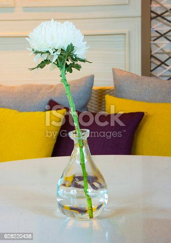 946294510 istock photo FLOWER IN THE GLASS-VASE ON TABLE IN HOUSE LIVING ROOM 628220438