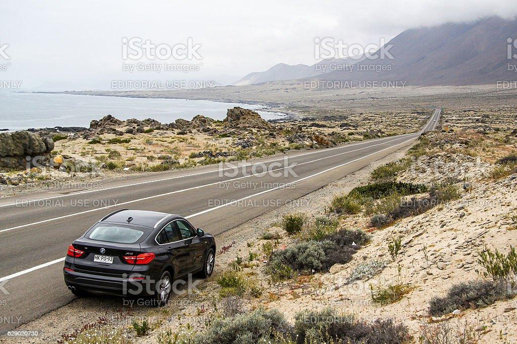 BMW F26 X4 Atacama, Chile - November 14, 2015: Black motor car BMW F26 X4 is parked at the roadside. 4x4 Stock Photo