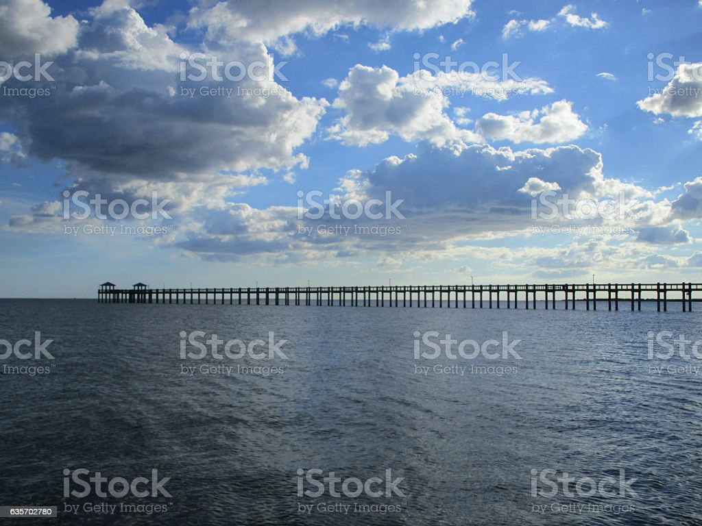 CLOUDY SKY OVER PIER royalty-free stock photo