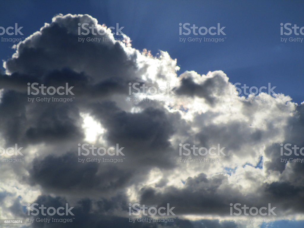 CLOUD WITH LIGHT THROUGH THE CENTER royalty-free stock photo