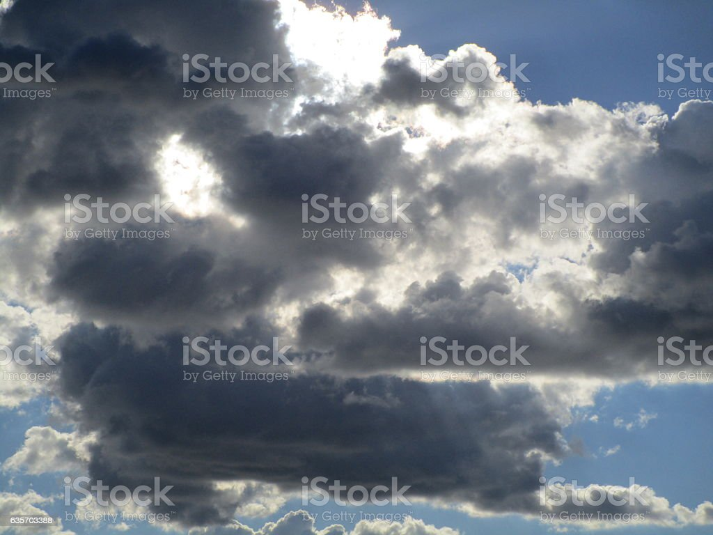 POINTS OF LIGHT ON MOODY CLOUDS royalty-free stock photo