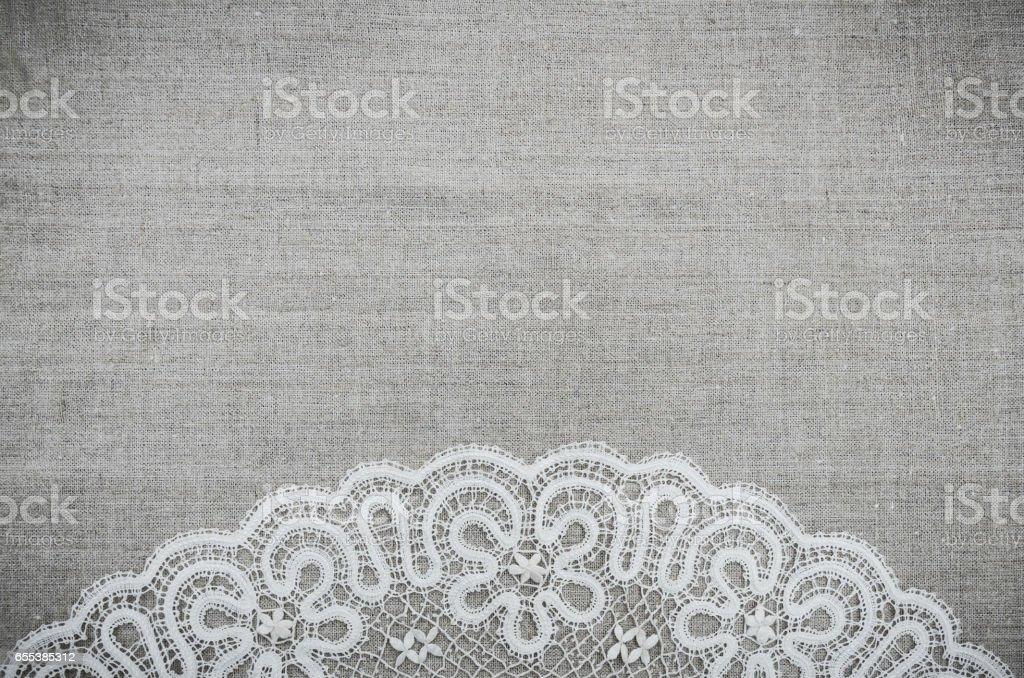 Льняная ткань и белое кружево stock photo