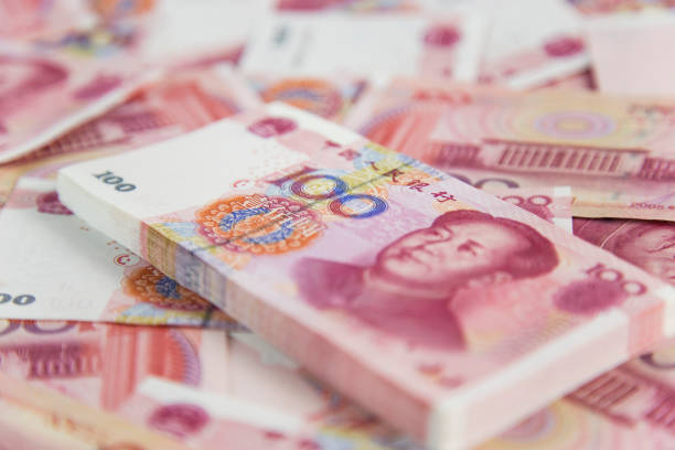 RMB Many of China's one hundred yuan in white background chinese currency stock pictures, royalty-free photos & images