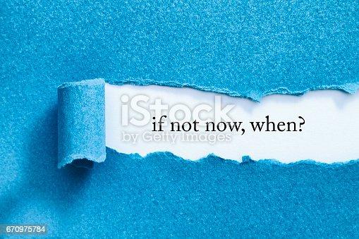 IF NOT NOW, WHEN? message written under torn paper.
