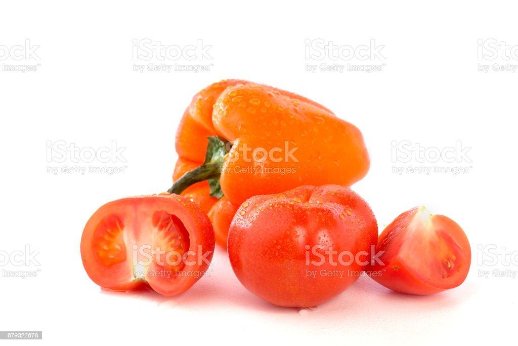 Помидоры, болгарский перец на белом фоне royalty-free stock photo