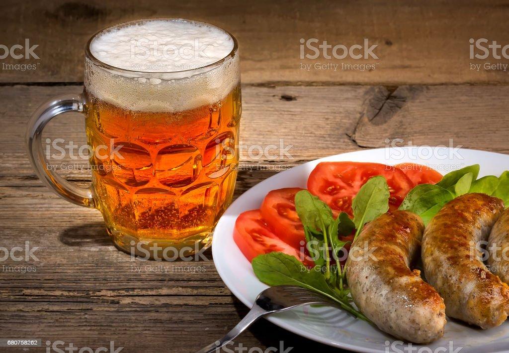 Пиво и сосиски stock photo
