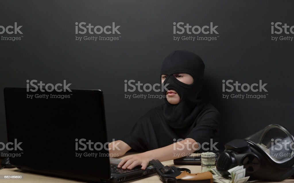 THE LITTLE BOY IN THE MASK OF THE TERRORIST stock photo