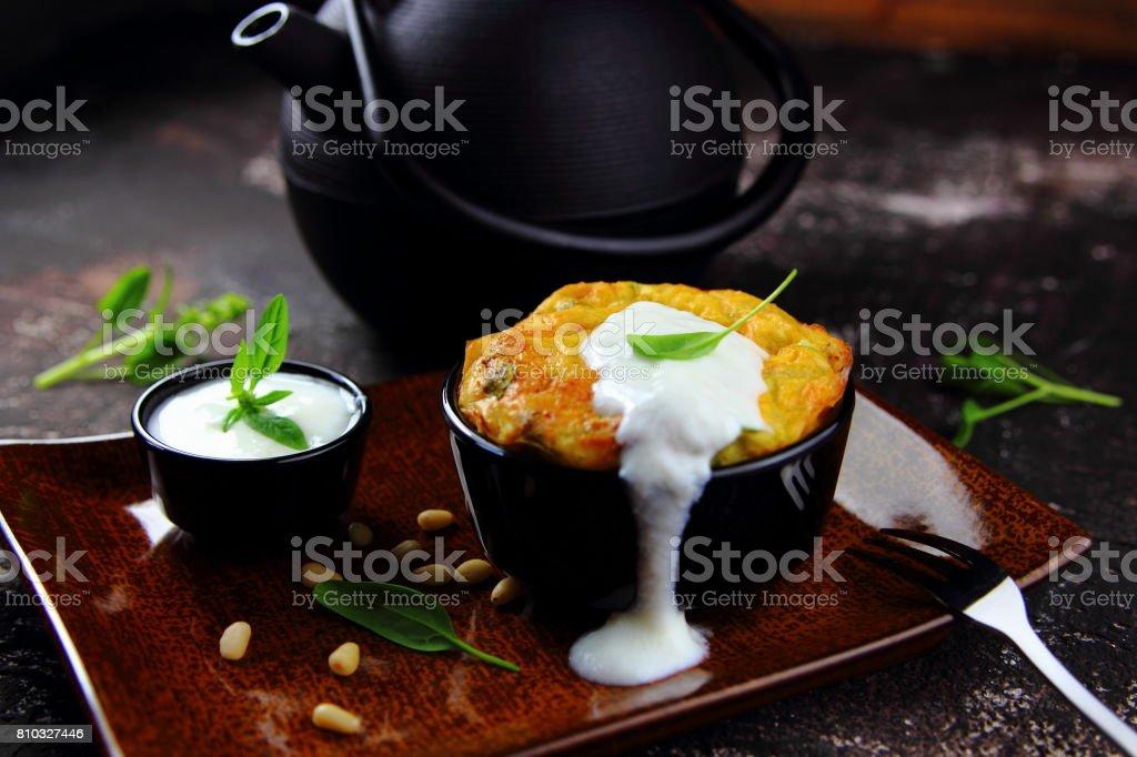 картофельная запеканка со шпинатом stock photo