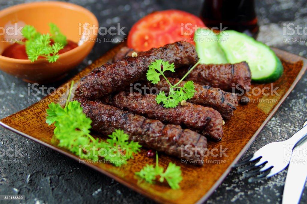 колбаски гриль с петрушкой stock photo