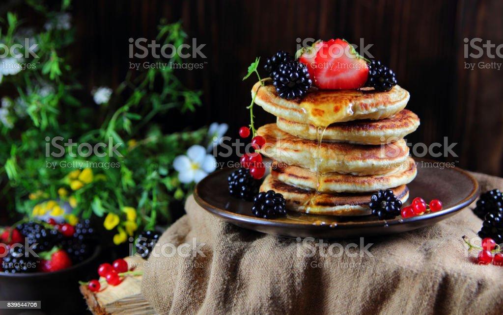 оладьи со свежими ягодами stock photo