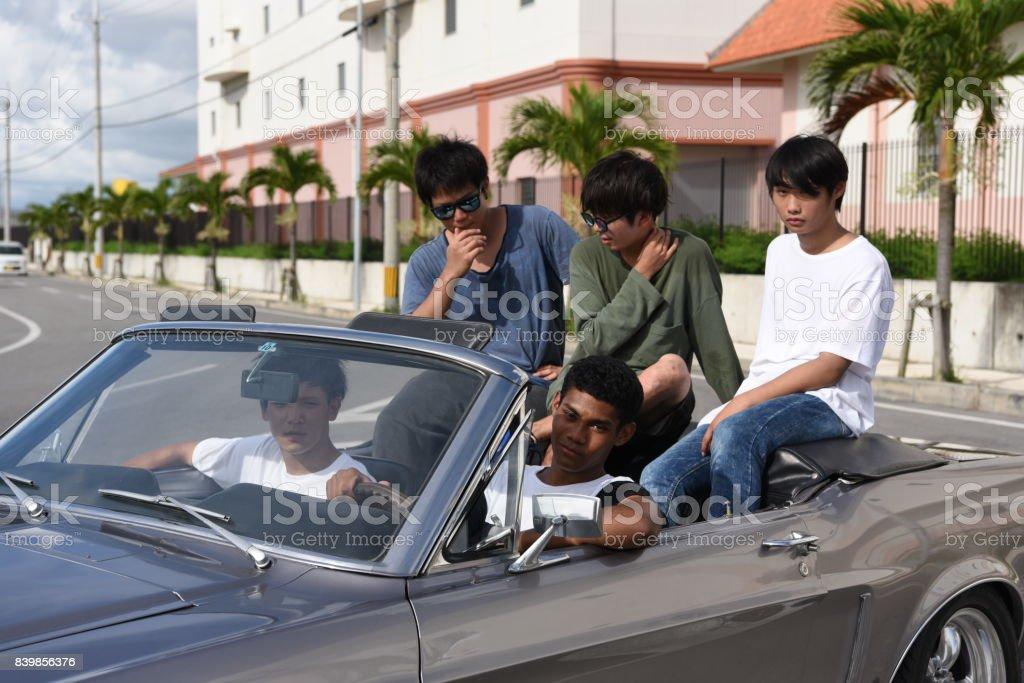 車でドライブする仲間たち stock photo
