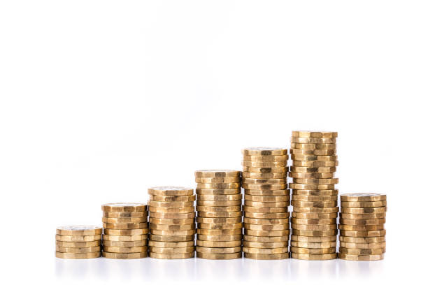 GBP Piles of pound coins in a chart format british currency stock pictures, royalty-free photos & images