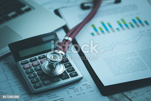istock STETHOSCOPE GRAPHICS AND CALCULATOR CONCEPT 847085386