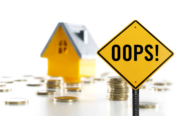 "OOPS! ""OOPS!"" traffic sign in front of a toy house and coins mistake stock pictures, royalty-free photos & images"