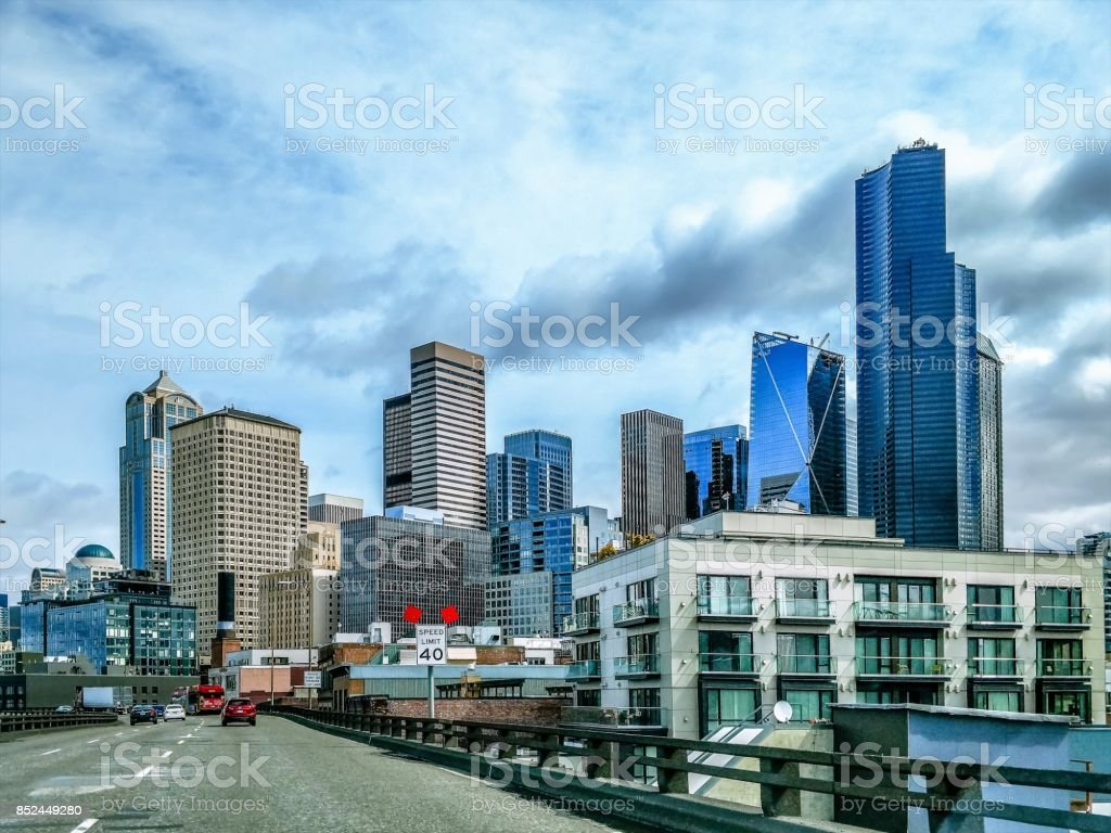 SEATTLE WASHINGTON CITYSCAPE SKYLINE ON PARTLY CLOUDY DAY stock photo