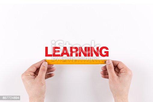 850892616 istock photo BUSINESSMAN MEASURING LEARNING 857724894