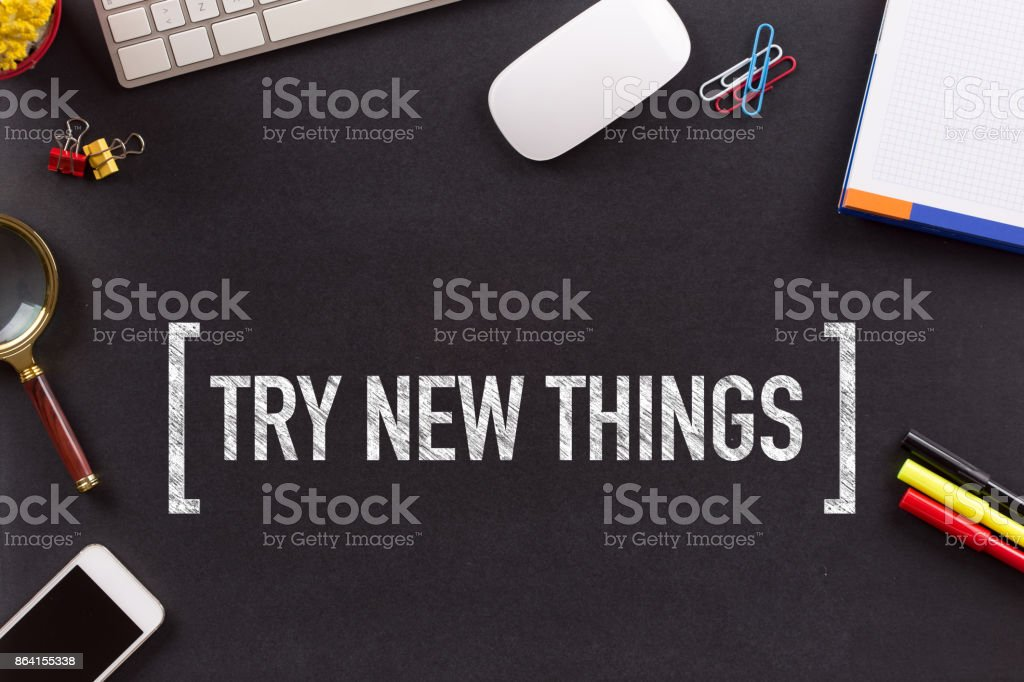 TRY NEW THINGS CONCEPT ON BLACKBOARD royalty-free stock photo