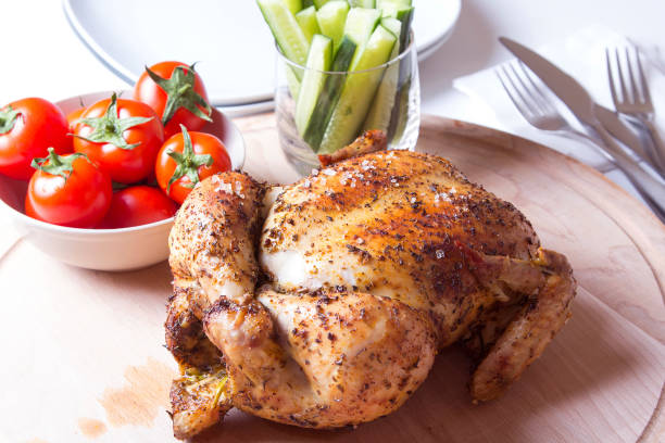 курица запеченная на соли - girarrosto foto e immagini stock