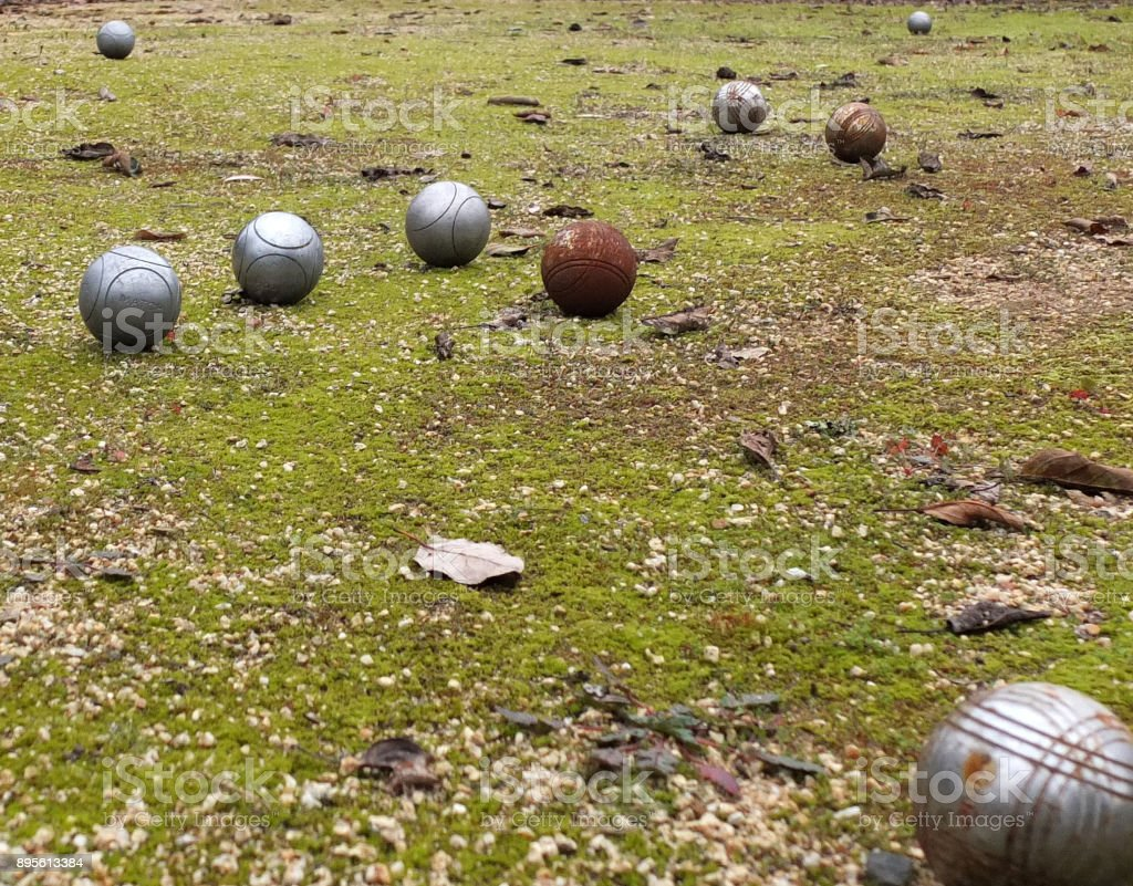 PETANQUE BALLS ON GRASS stock photo